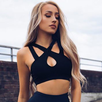 The new holes crossover shouldered with hollowed-out yoga vest bra black top