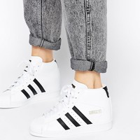 Adidas Originals Superstar Concealed Wedge White High Top Trainers at asos.com