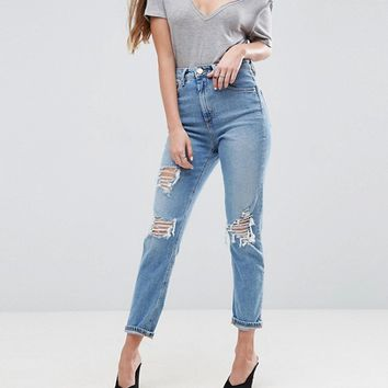ASOS FARLEIGH High Waist Slim Mom Jeans in Miracle Light Wash with Rips at asos.com