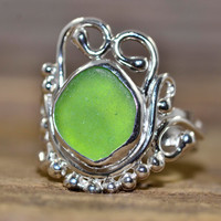 Handmade unique green sea glass ring in a custom sterling silver setting.
