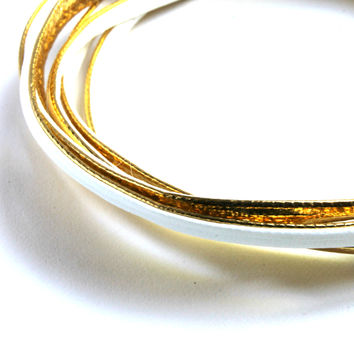 """""""Plenty of Layers"""" White And Gold Faux Leather Bracelet"""
