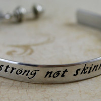 "Hand stamped Aluminum Bracelet Weight lifting, work out, Personal Trainer Jewelry ""Strong not Skinny"""