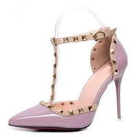 Pointed studded thick heels