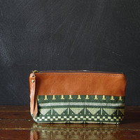 the 9-inch ZIPPER pouch. tapestry and eco leather.