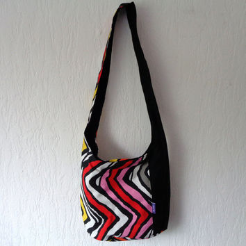 Fabric shoulder bag with zipper pocket, chevron print.