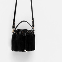 FRINGED BUCKET BAG WITH LONG STRAP