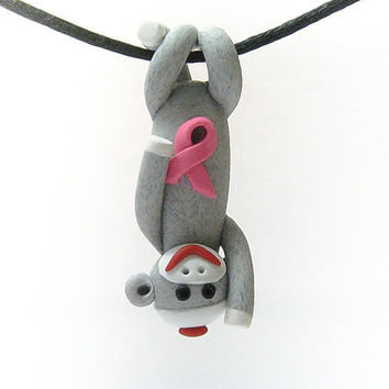 Sock Monkey Pendant Clutching Pink Awareness Ribbon by MagicByLeah