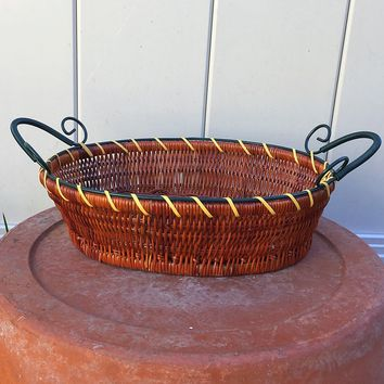 Oval Woven Basket with Green Metal Handle