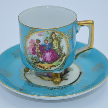 Andrea Sadek Teal Victorian Tea Cup & Saucer Vintage Courting Couple Aqua Demitasse Footed Cup and Saucer Hand Painted Made in Japan