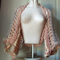 Openwork lacy shrug wide sleeves fits most medium large extra large women in warm neutrals