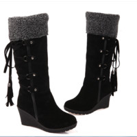 After the frosted with tassel tall canister boots Black