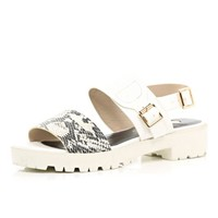 White cleated sole snake strap sandals - flat sandals - shoes / boots - women
