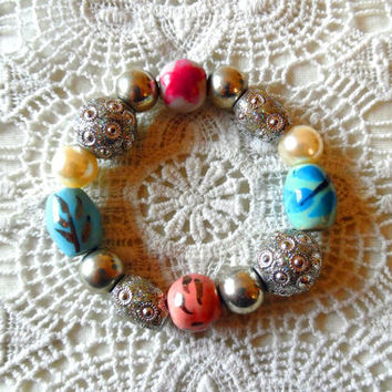 clay bead bracelet / faux pearl / sparkly / glazed beads / flower / star fish / silver bracelet / elasticated bracelet / vintage bracelet