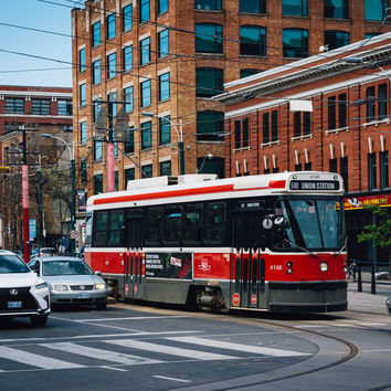 Streetcar and the intersection of Queen West and Spadina Avenue, in the Fashion District, Toronto, Ontario.