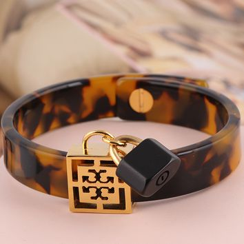 Tory Burch leopard resin letter T small lock pendant variety style wide bracelet