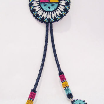 Native American beaded bolo tie with a traditional Hopi Sun Face design.