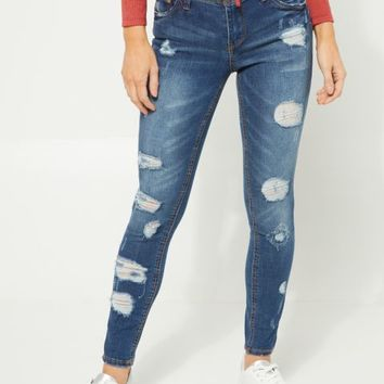 Dark Wash Midrise Destroyed Skinny Jeans in Regular