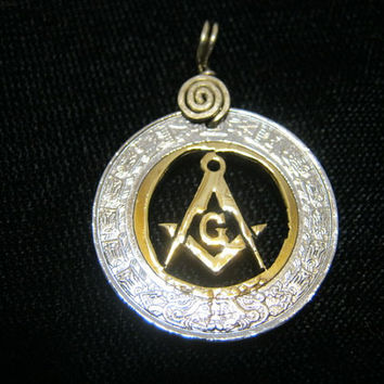 Masonic Symbol square and compas hand made out of one two tone mexican coin