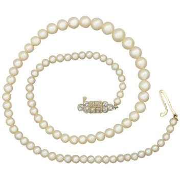 Single Strand Pearl Necklace 0.56 Carat Diamond 15 Karat Gold Clasp