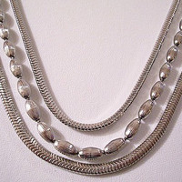 Monet Omega Weaved Triple Strand Necklace Choker Silver Tone Chain Vintage Brushed Rice Beads Decorative Clasp