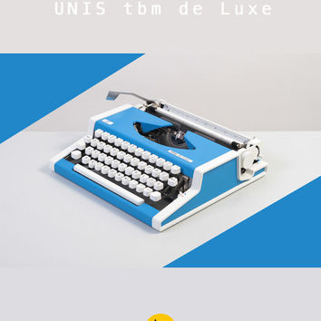 1970'S Unis tbm deLuxe Typewriter. Refurbished. Blue and white colors. Portable. Remarkable design. Case.