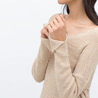 Sweater with side slits