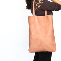 Peach leather tote bag by Leah Lerner