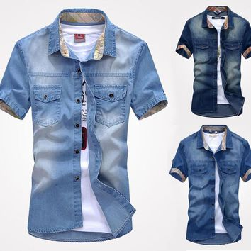 Men's Slim Fit Denim Shirt with stylish wash. Casual, vintage look for any occasion.