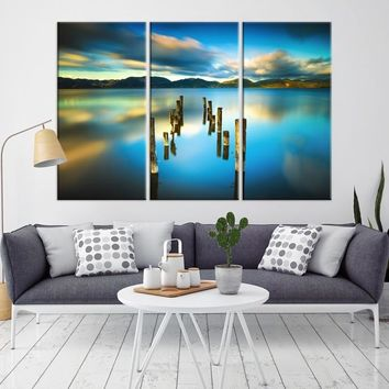 13815 - Old Piles in the Lake with Cloud Reflection Wall Art Canvas Print