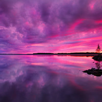 Sunset in Finland over a lake surreal by behindmyblueeyes