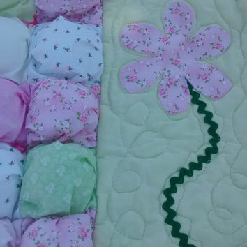 Unique crib quilt with 'biscuit' center and quilted border with appliqued flowers!
