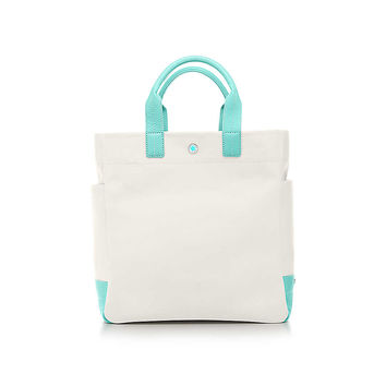 Tiffany & Co. - Lindy tote in natural canvas with Tiffany Blue® leather trim.