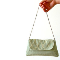 Jade green clutch in recycled damask with metal chain strap and organic fabric for the lining