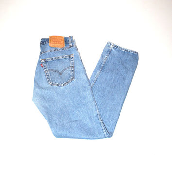 faded light wash levis jeans 90s vintage mom jeans 1990s minimalist stone wash denim levis size 29