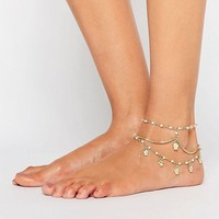 ASOS Multirow Faux Pearl & Charm Anklets at asos.com