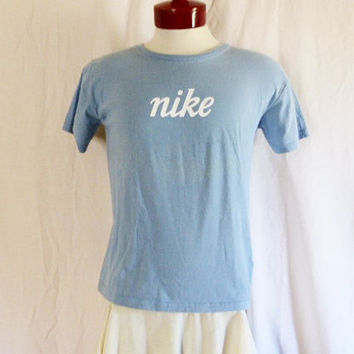 vintage 90's Nike pastel light blue graphic t-shirt white script spellout logo print crew neck tee men women unisex made in usa slim medium