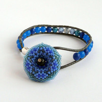 Wrap beaded bracelet with beaded flower button, blue glass beads and silver leather, single wrap