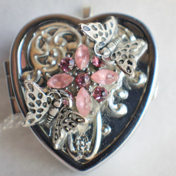 Music box locket,  heart shaped  locket with music box inside, in silver with silver filigree, rhinestones and butterfly on front cover