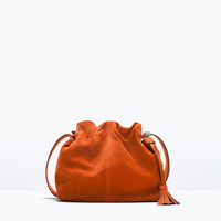 Leather bucket bag with tassel