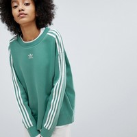 adidas Originals adicolor Three Stripe Sweatshirt In Green at asos.com