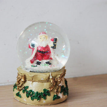 Vintage snow globe, Santa snowglobe with Christmas decor base, open armed, caped Santa in snowglobe, Xmas collectible, early nineties