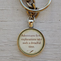 Alice In Wonderland Keychain. Adventures First Quote Keychain. Silver Tone keychain.