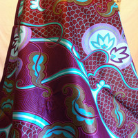 African Wax Print Fabric by the HALF YARD.  Floral and scales in maroon, purple, lavender,  turquoise, gold, and blue.
