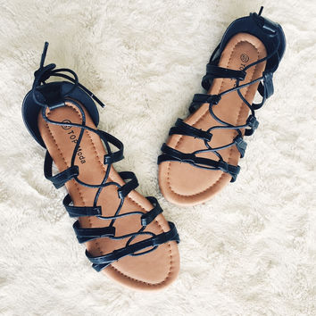 A Lace Up Sandal in Black
