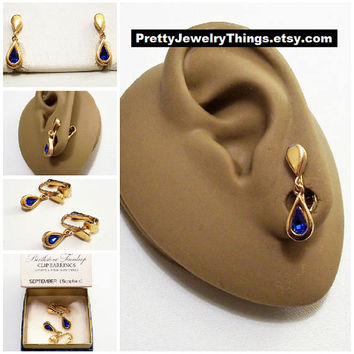 Avon Blue Sapphire Crystal Teardrop Clip On Earrings Gold Vintage 1977 Austrian September Birthstone Glass Stone Bezel Set Wide Band Edge
