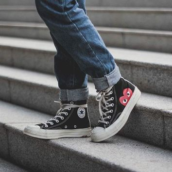cdg converse high top on feet