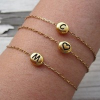 Charlie and Marcelle Initial bracelet in gold with free worldwide shipping as seen in People Style Watch