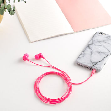 Neon pink earbuds