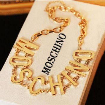 ONETOW MOSCHINO metal letters gold thin waist belt F