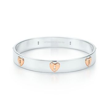 Tiffany & Co. -  Tiffany Locks heart lock bangle in sterling silver and 18k rose gold, medium.